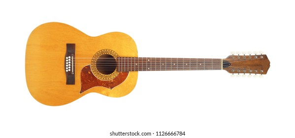 Musical instrument - Front view vintage twelve-string acoustic guitar isolated on a white background.