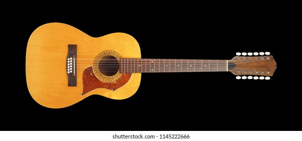 Musical instrument - Front view vintage twelve-string acoustic guitar isolated on a black background.