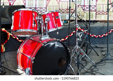 Musical instrument - Full drum kit set on stage and other electronic equipment