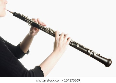 Musical instrument oboe classical orchestra player hands close up on white