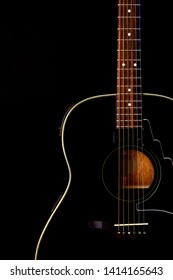 musical instrument wood acoustic six-string guitar isolated on blackbackground