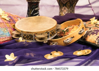 musical instruments of a bellydance percussiongroup with darbuka's, tambourines and zills