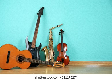 Musical instruments on turquoise wallpaper background - Shutterstock ID 311173274