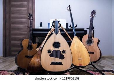 Musical instruments. Piano, guitar, oud, baglama.