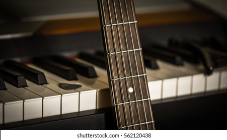 musical instruments piano keys and acoustic guitar closeup, concept, musical composition and creativity