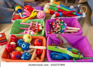 Musical instruments and toys for children in the form of toys, many colors in baskets that include flutes, maracas, bells etc.