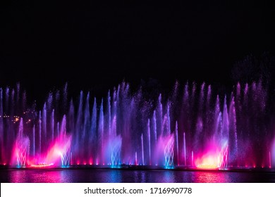 Musical multimedia fountain with colorful lights at night. Ukraine, Vinnitsa