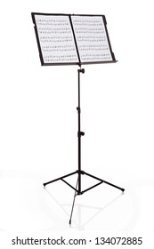 Musical Notes On Stand Over White Background