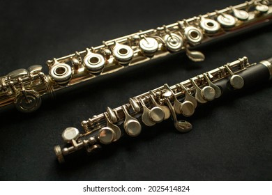 Musical wind instrument piccolo flute and brass flute. High quality photo