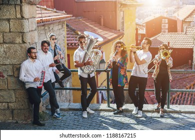 Musician band playing together outdoor on European  city street