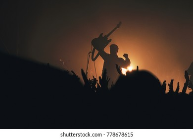 Musician with a guitar at a concert