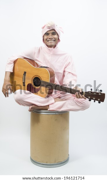 Musician with guitar on with studio