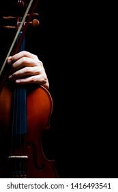 musician hand on violin, isolated on black. music background