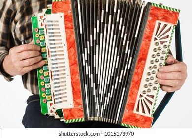 Musician hand playing accordions closeup. isolated on white background