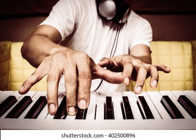 musician hands playing white piano + art filter for music background