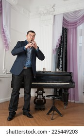 musician holds the instrument in the hands of the living room