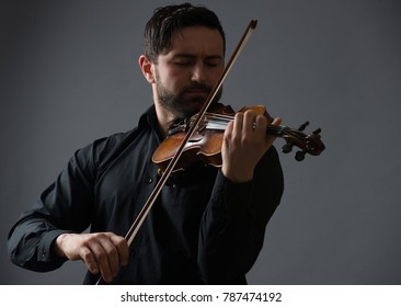 Musician man playing the violin. Musical instrument on performer hands. Classic music concept.