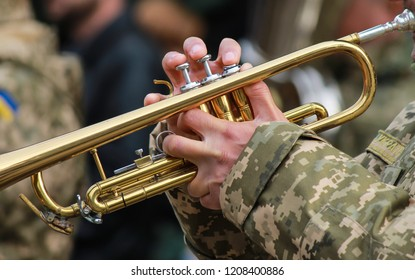Musician of military orchestra of the Ukrainian army plays the trumpet, the Armed Forces of Ukraine, Ukraine army, Ukrainian war, conflict. Defender Day Ukraine