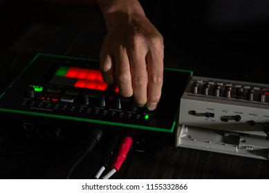 musician mixing electronic music