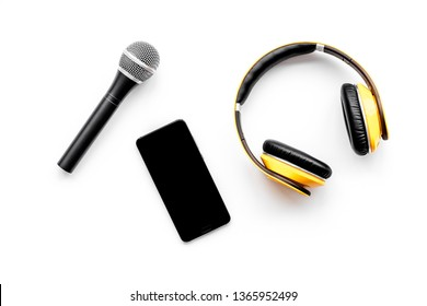 musician office desk with mobile phone, microphone and headphones white background top view copyspace