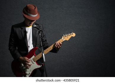 musician play guitar and sing a song on dark,music concept
