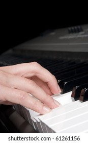 Musician play piano synthesizer - piano key and woman hand closeup