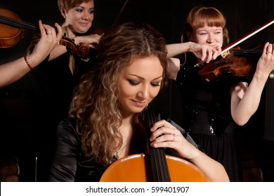 Musician play violin on dark background