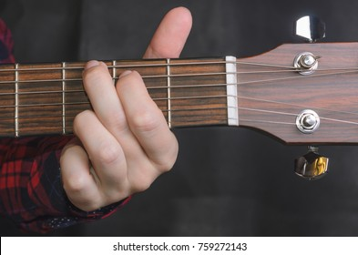 Musician Playing accord G on acoustic guitar, close up