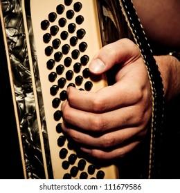 musician playing accordion in studio