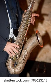 Musician playing alto saxophone on a concert jazz