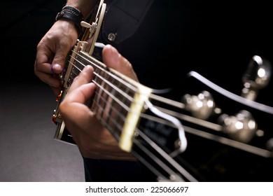 musician playing guitar, close-up shot