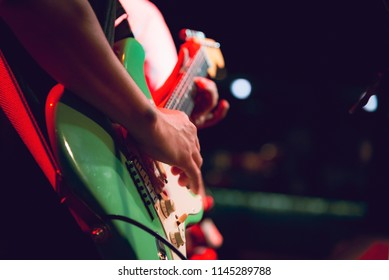 Musician Playing guitar and concert concept.Live music background.Music festival.Instrument on stage and band,Concept background,Vintage tone.