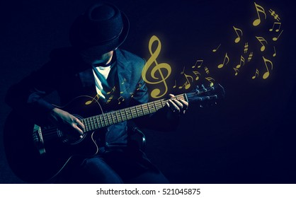 Musician playing the guitar with music notes on black background,music concept
