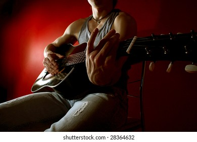 Musician playing guitar on re? background