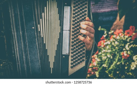 Musician playing his accordian during a street festival. concept, background