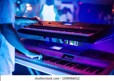 Musician playing keyboard during live performance