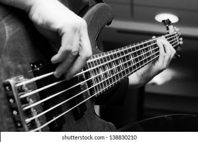 Musician playing on bass guitars.