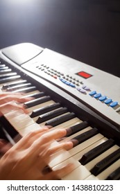 Musician playing on keyboards in concert