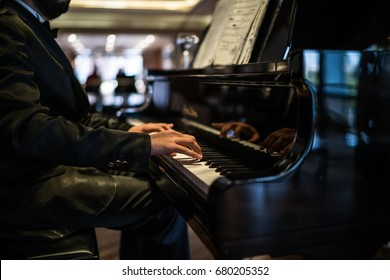 musician playing piano in the hotels lobby.