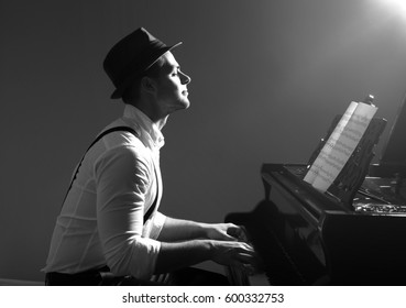 Musician playing piano toned in black and white