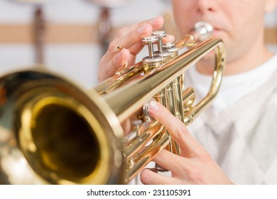 Musician playing a trumpet with selective focus
