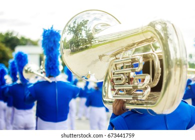 Musician playing tuba in marching band