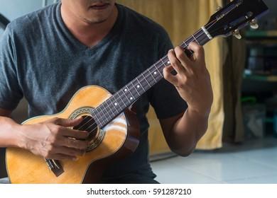 Musician playing ukulele.
