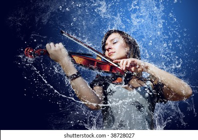Musician playing violin under water