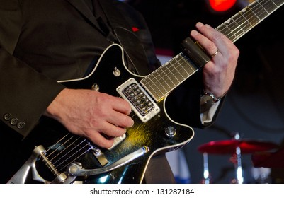 Musician plays the electric guitar at a blues festival