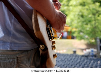 Musician plays his electric guitar during a soundcheck on stage