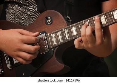 Musician Plays His Gibson Les Paul Studio Electric Guitar