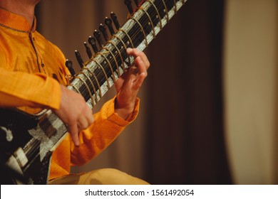 The musician plays the Indian instrument sitar