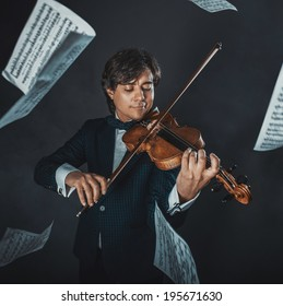 Musician plays the violin and music sheets flying around