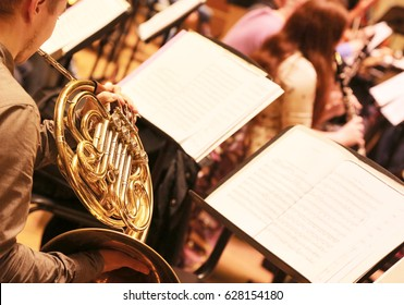 Musician plays a wind instrument. Rehearsal Symphony orchestra.
